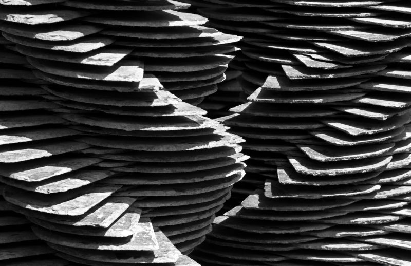 Layers upon layers :: Detail of a sculpture comprising seven pillars of piles of slates.